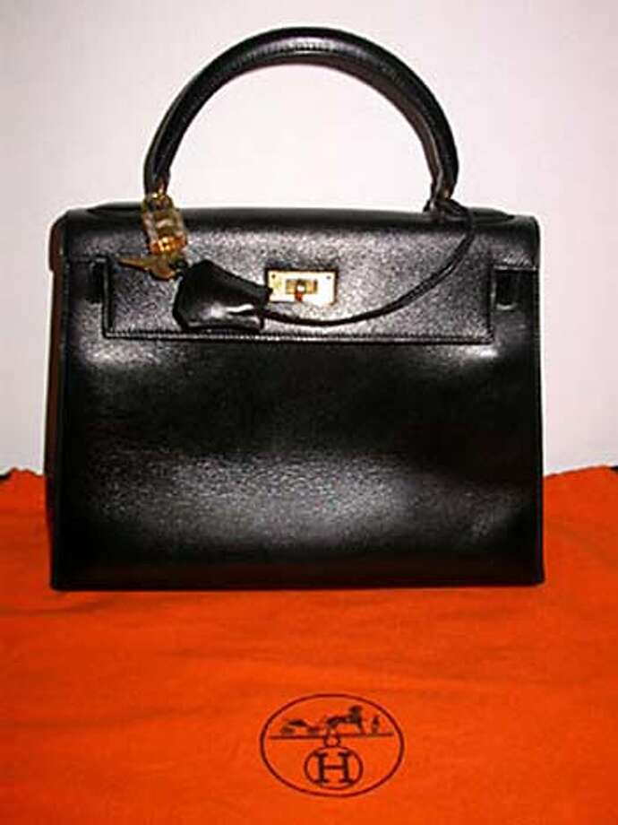 Hermes-Paris, black leather, authentic Kelly Bag.  Hermes-Paris, authentic, beautiful black leather Kelly Bag. Features flap closure, double strap security, brass twist-latch with Hermes lock and key to keep your contents private and safe. Inside are 3 large pockets; 2 on one side and 1 large one opposite. Comes with original Hermes storage pouch, tan. Measures 13� from bottom to top of handle, 13� wide and 5� deep. Condition is excellent.  Excellent Condition  Price: $3200.00 Handout