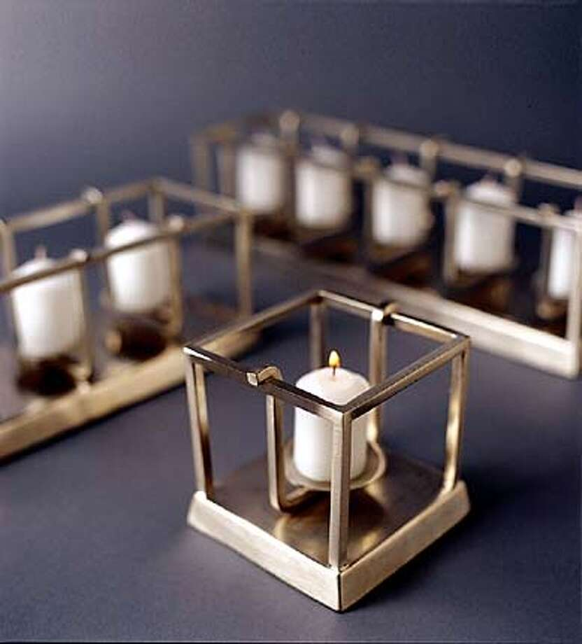 The Albion votive holder from the Wingard outlet in San Francisco is made of brushed nickel over cast brass and comes in three sizes, $10-$25.
