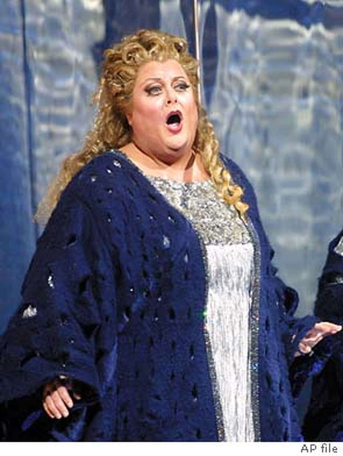 "Deborah Voigt sings during a dress rehearsal of the new Herbert Wernicke production of Strauss' opera, ""Die Frau ohne Schatten,"" Monday, Dec. 10, 2001, at the Metropolitan Opera in New York. (AP Photo/Shawn Baldwin)"