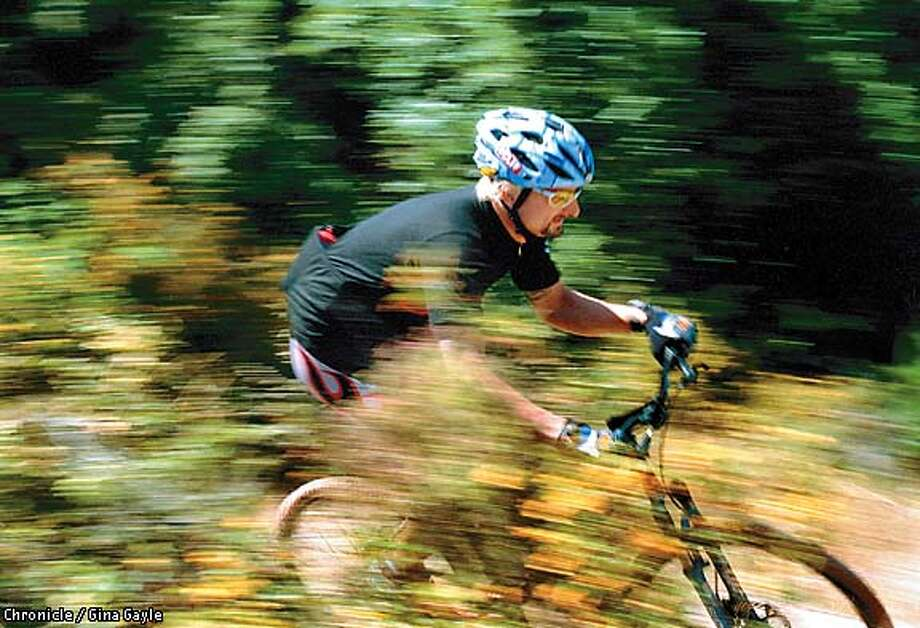 Professional racer Chris Cosentino rides a trail in Marin County. Chronicle photo by Gina Gayle