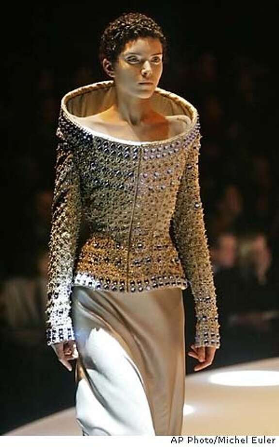 A model sports an evening gown by British designer Alexander McQueen during his Fall-Winter 2004-2005 ready-to-wear fashion collection, presented in Paris Friday, March 5, 2004. (AP Photo/Michel Euler) Photo: MICHEL EULER