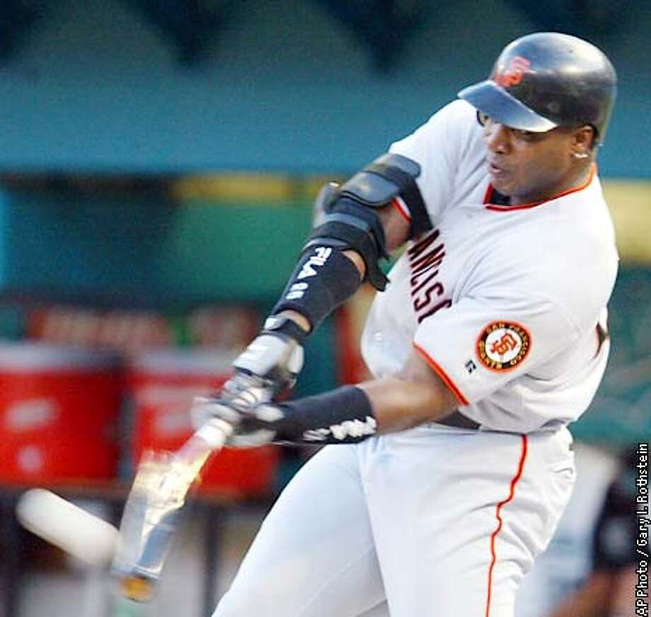 San Francisco Giants' Barry Bonds breaks his bat as he hits a solo home run off Florida Marlins pitcher Josh Beckett in the first inning on Saturday, Aug. 17, 2002, in Miami. (AP Photo/Gary I. Rothstein) Photo: GARY I. ROTHSTEIN