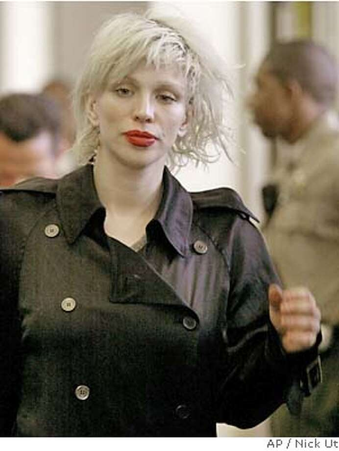 Courtney Love arrives at the Los Angeles County Superior Courthouse in Beverly Hills, Calif., Friday , April 30, 2004, for a preliminary hearing on two felony drug possession charges. (AP Photo/Nick Ut ) Photo: NICK UT
