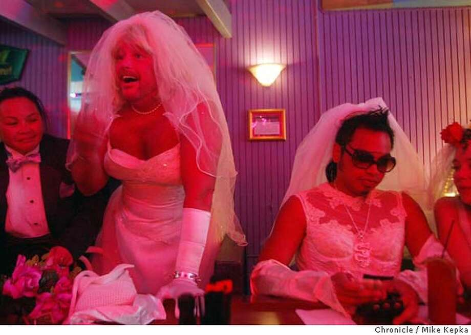 Dressed as brides at Ginger's Trios Bar on Kearny in San Francisco Pilar Jesus, Marc Williams, Donomic Tinio and Maya Pressnall pay their tab and get ready to participate in the 6 th annual Brides of March event where a group of 30 or so revelers dressed as brides paraded throgh San Francisco's Union Square stopping at places like Wallgreens and Selix tux rentals along the way. Brides of March is an underground event started by San Franciscan Michele Michele (cq) in 1998 in conjunction with the Cacophony Mens Society after being inspired by a rack full of used wedding gowns he saw at a local thrift store. Mike Kepka / The Chronicle Photo: Mike Kepka