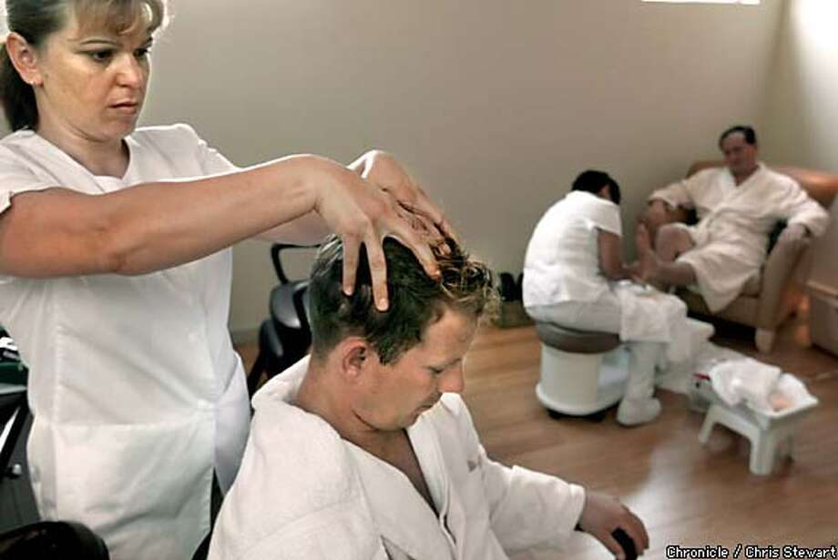 Down time: Scott Robinson, a real estate broker with Alain Pinel Realty, gets a scalp treatment from massage therapist Snjezana Marc at Thermae Spa while Frank Ray Robles, CEO of Neopolitan Networks, gets a pedicure from nail technician Lulu Bolivar. Chronicle photo by Chris Stewart