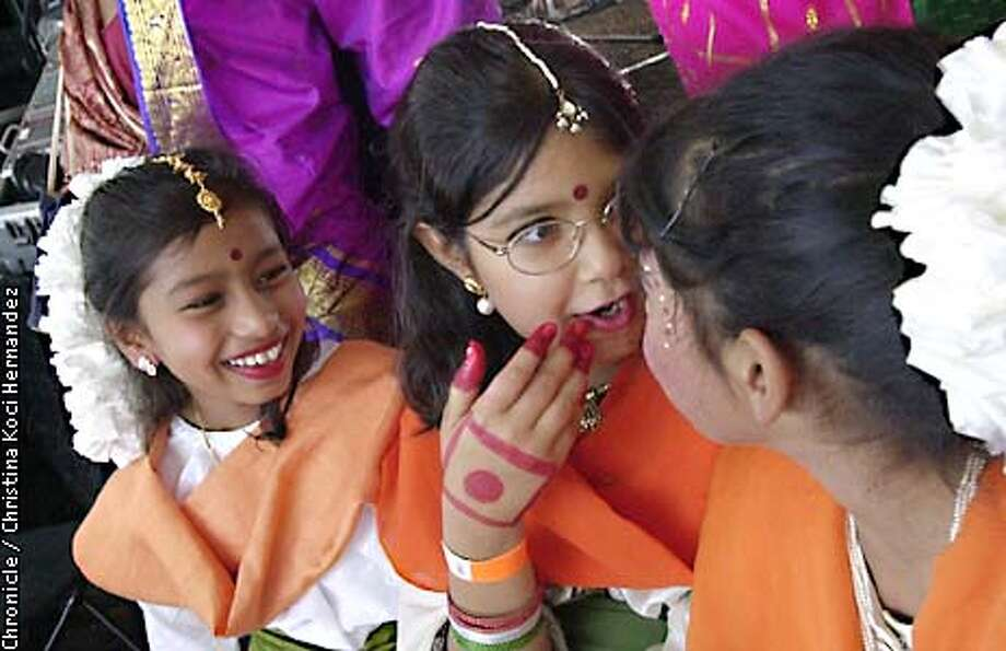 CHRISTINA KOCI HERNANDEZ/CHRONICLE  Divya Gupta,age 9, Anchal Ahuja,age 8, and Tanya Nandykazi, age 9, wait their turn to perform Indian classical dance at the festival. 54th anniversary of India's independence from Britain, celebration at James logan high School in Union City. Photo: CHRISTINA KOCI HERNANDEZ