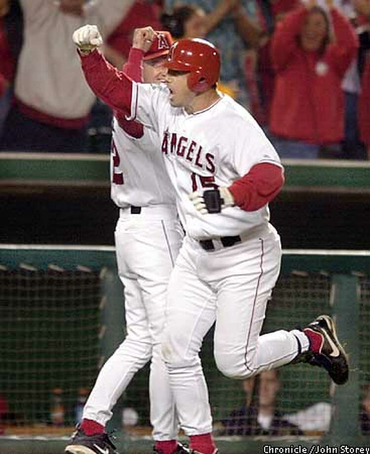 Angels Tim Salmon celebrates his game winning homerun in the eighth inning. The San Francisco Giants play the Anaheim Angels in Game 2 of the World Series at Edison Field in Anaheim, Ca. October 20, 2002. John Storey/San Francisco Chronicle Photo: John Storey