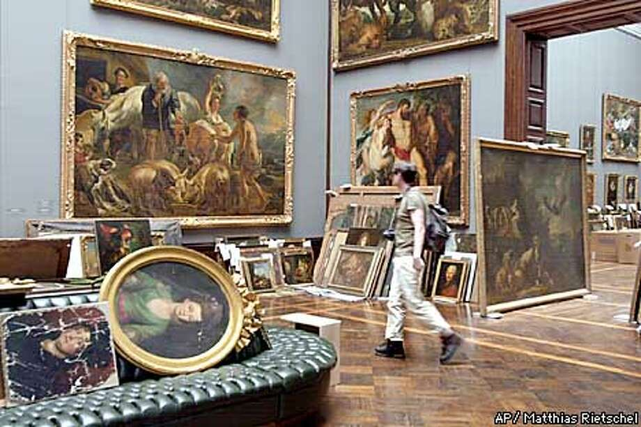 An exhibition room of the Old Masters Painting gallery in Dresden, eastern Germany, is shown Friday, Aug. 16, 2002. More than 4,000 exhibits, normally stored in a basement of the building, were carried to one of the higher floors because high water of the river Elbe flooded the Zwinger building, where the gallery is located. (AP Photo/Matthias Rietschel) Photo: MATTHIAS RIETSCHEL