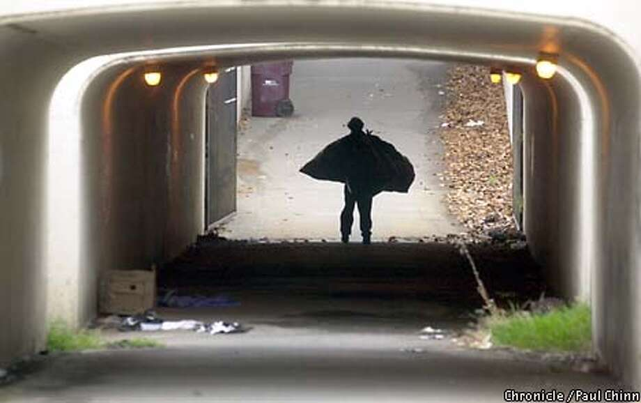 Oakland's pedestrian tunnels are magnets for homeless people looking for a covered place to stay and taggers with cans of spray paint. Chronicle photo by Paul Chinn