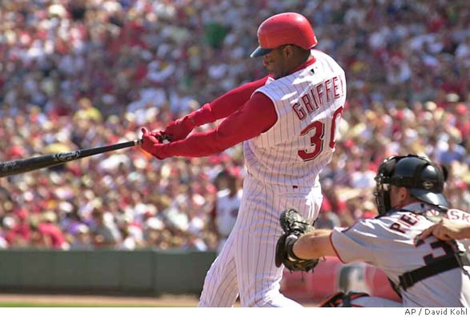 Cincinnati Reds' Ken Griffey, Jr., hits his second home run of the game off San Francisco Giants' pitcher Scott Eyre in the eighth inning, Saturday, May 8, 2004 in Cincinnati. Giants catcher AJ Pierzynski is at right. The Reds won, 6-4. (AP Photo/David Kohl) Photo: DAVID KOHL
