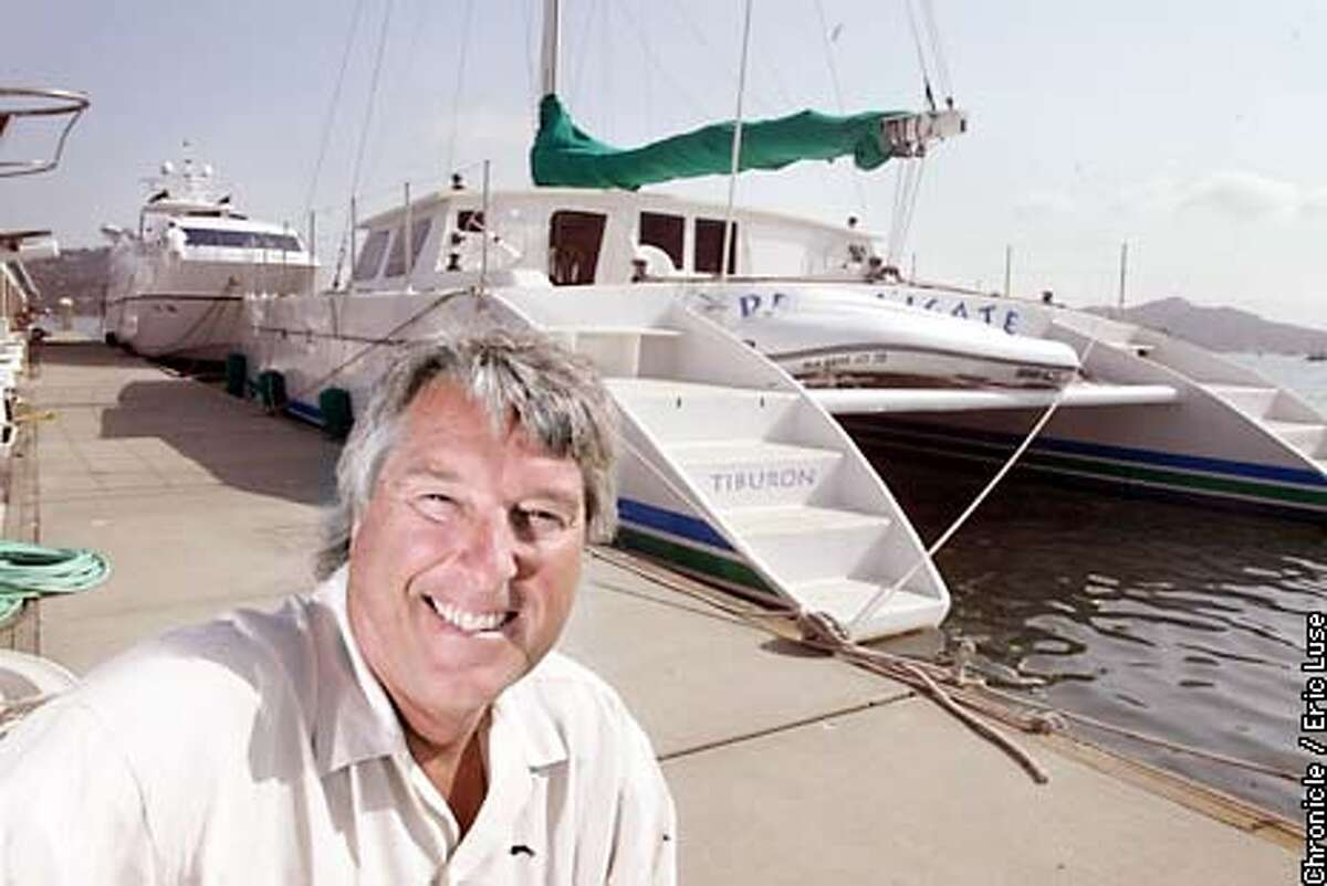 Richard Spindler, founder of Latitude 38 in front of his catamaran in Sausalito. BY ERIC LUSE/THE CHRONICLE