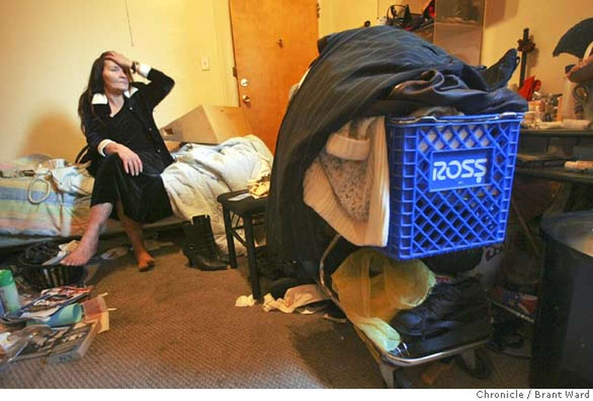 Back in her hotel room at the Windsor Hotel, Barbara relaxes after her morning at the hospital and she will watch television in the afternoon. She is constantly helping her friends, a friend with a shopping cart has parked it in her room for a while. Barbara Spillane is a longtime homeless woman who now receives support housing at the Windsor Hotel on Eddy Street in San Francisco. BRANT WARD / The Chronicle MANDATORY CREDIT FOR PHOTOG AND SF CHRONICLE/ -MAGS OUT