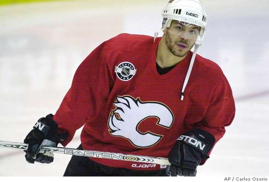 Calgary Flames winger Jarome Iginla skates during the Flames' off-day skate at Joe Louis Arena in Detroit, Friday, April 23, 2004. The Flames beat the Detroit Red Wings 2-1 in overtime Thursday in a second-round NHL playoff series. Game 2 is Saturday. (AP Photo/Carlos Osorio) Photo: CARLOS OSORIO