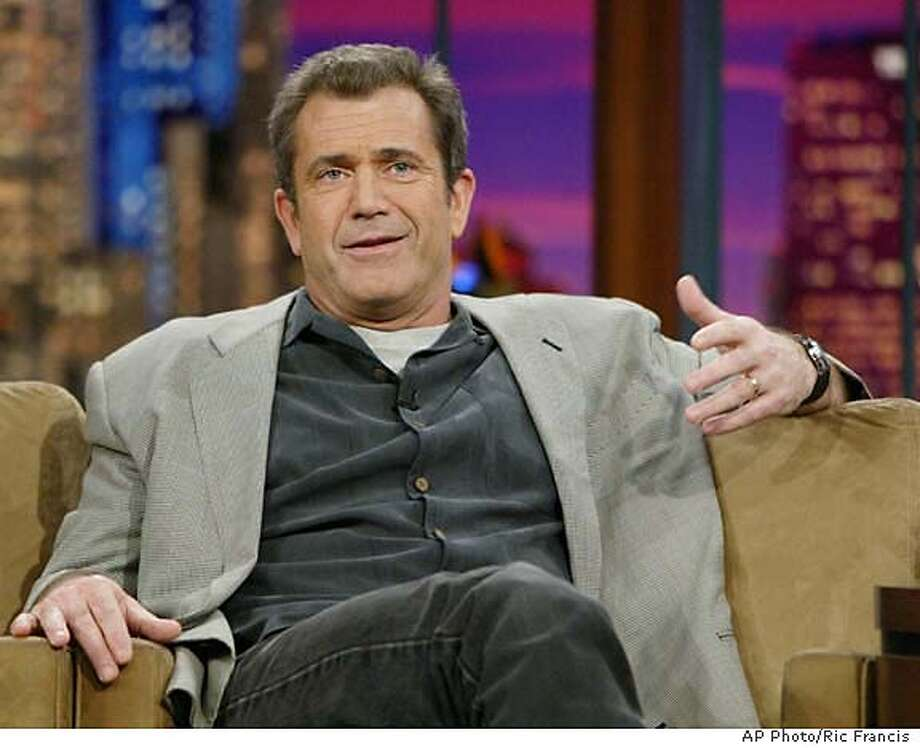 """Mel Gibson, director, co-writer and producer of the new movie """"The Passion of the Christ,"""" appears on the Tonight Show with Jay Leno Thursday, Feb. 26, 2004, in Burbank, Calif. The film opened last Wednesday. (AP Photo/Ric Francis) Photo: RIC FRANCIS"""