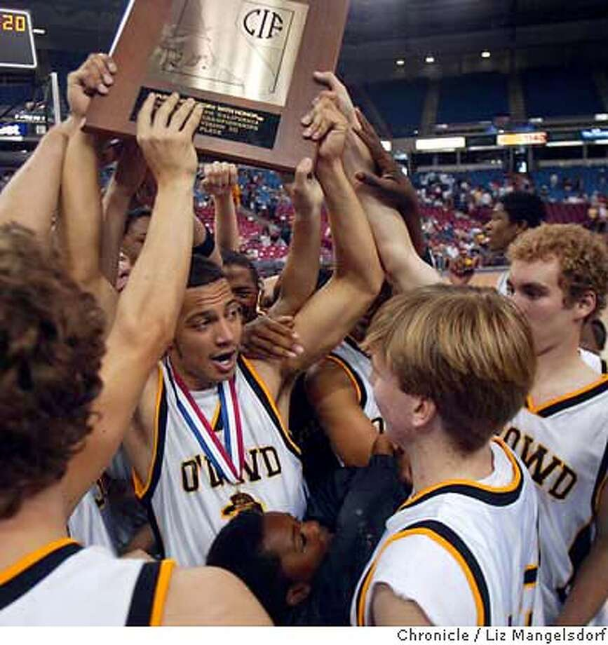 Event on 3/13/04 in Sacramento.  O'Dowd's #22 David Nysaether holds up the trophy after the game.  Bishop O'Dowd's boys basketball team beats St. Ignatius 48-26 in the Northern California Championship game at the Arco Arena in Sacramento.  Liz Mangelsdorf / The Chronicle Photo: Liz Mangelsdorf