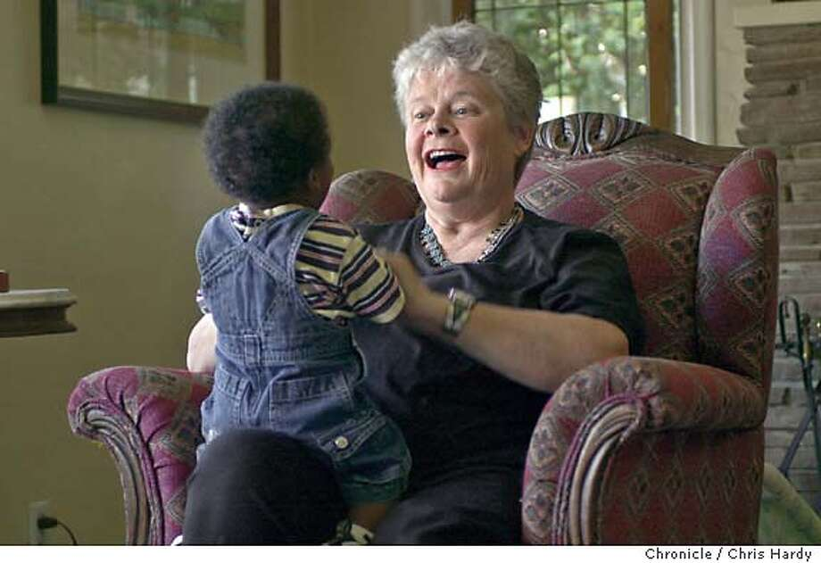 foster09_109_ch.JPG  Diane plays with a 10 month old baby.  Profile of Diane Carleson, who has been a foster parent in San Mateo County for thirty years.  Now, she specializes in taking care of medically fragile infants and has nursed as many as 500 infants back to health in the home she once shared with her husband. She is also, at retiring age, taking care of her mother and her adopted 17-year-old daughter Tamisha.  at San Mateo,CA on 5/3/04  San Francisco Chronicle/Chris Hardy MANDATORY CREDIT FOR PHOTOG AND SF CHRONICLE/ -MAGS OUT Photo: Chris Hardy