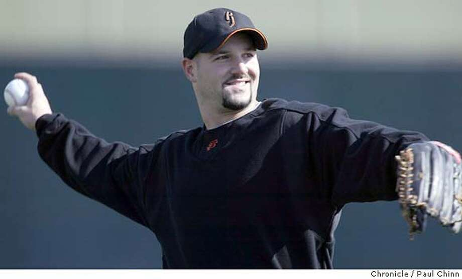 giants26_125_pc.JPG Outfielder Dustan Mohr loosens up at Scottsdale Stadium. The San Francisco Giants held its first full-squad workout on 2/25/04 in Scottsdale, AZ. PAUL CHINN / The Chronicle MANDATORY CREDIT FOR PHOTOG AND SF CHRONICLE/ -MAGS OUT Photo: PAUL CHINN