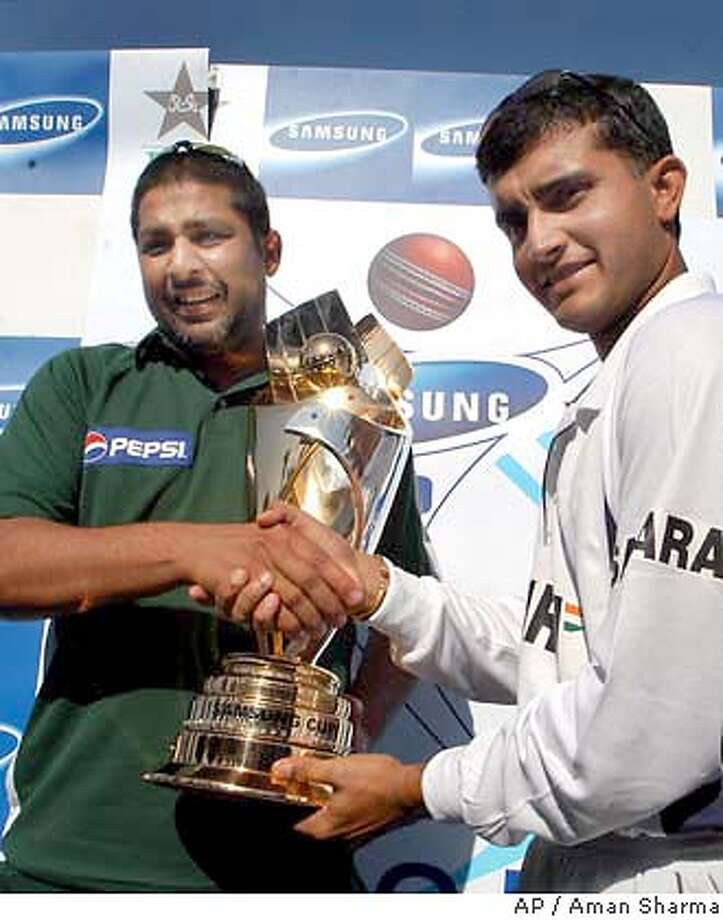 Captains Inzmamul Haq, left, of Pakistan and Sourav Ganguly of India pose with a cricket series trophy at National Stadium in Karachi, Pakistan, Friday, March 12, 2004. India and Pakistan will play its first one day international cricket match in Karachi, following their cricket tour of 5 one days and 3 test cricket matches in Pakistan. (AP Photo/Aman Sharma) Team captains Inzmamul Haq (left) of Pakistan and Sourav Ganguly of India pose with the series trophy in Karachi. ProductNameChronicle Photo: AMAN SHARMA