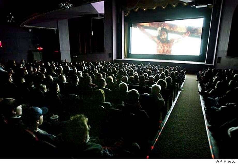 """Although the show didn't sell out, still, 303 people packed into the Liberty Theater in Wenatchee, Wash. on Wednesday, Feb. 25, 2004 for the opening of the emotional and graphic movie, """"The Passion of the Christ."""" (AP Photo/The Wenatchee World, Kelly Gillin) Photo: KELLY GILLIN"""
