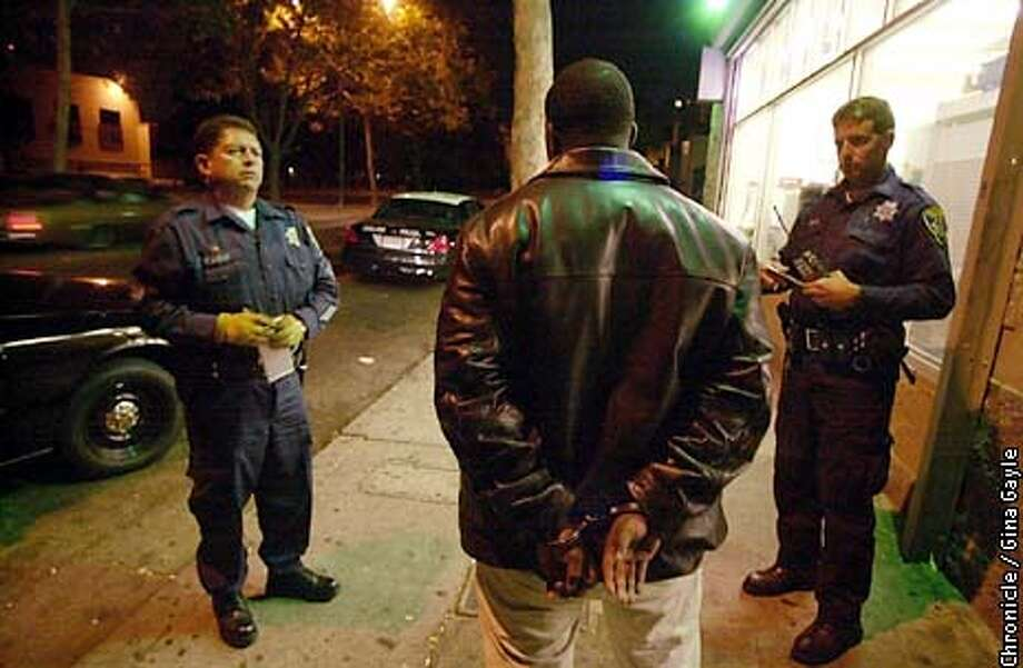 Sargent Fred Mestas (L) and Officer J. Cowles question a man who was standing on the corner of 18th and Market, a corner that has a lot of drug activity and in an area with a lot of violence. The Team did arrest two men that evening. Photo by Gina Gayle/The SF Chronicle. Photo: GINA GAYLE
