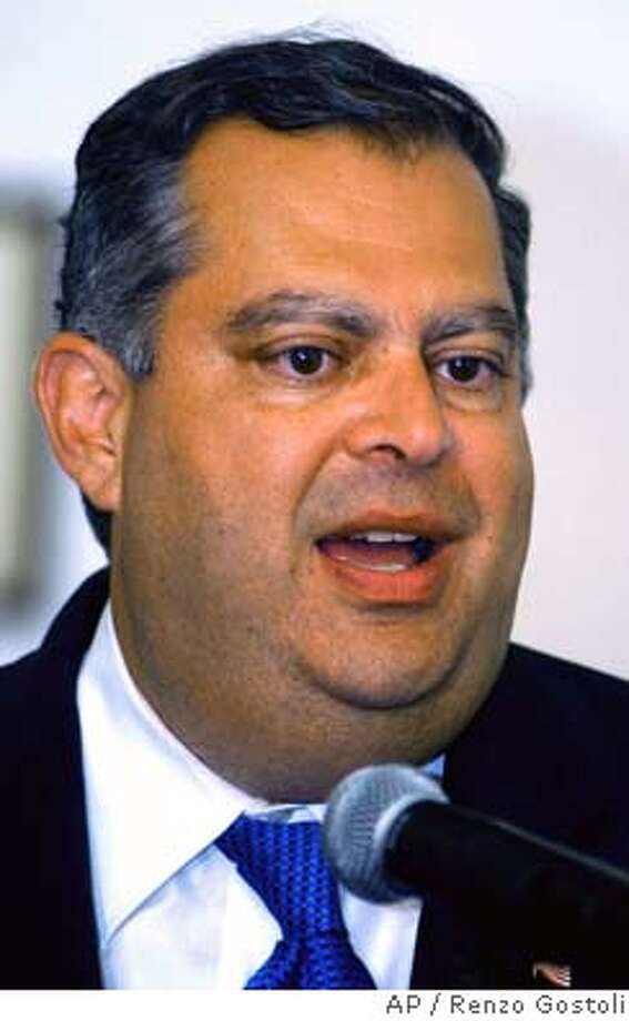US Energy Secretary Spencer Abraham talks to the midia during a presS conference at the US consulat in Rio de Janeiro, Brazil, Friday, April 16, 2004. (AP Photo/Renzo Gostoli) Photo: RENZO GOSTOLI