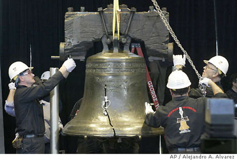 Employees of George Young Company lower the Liberty Bell onto the new pedestal inside the new Liberty Bell Center across from Independence Hall in Philadelphia, Thursday, Oct. 9, 2003. The movement and condition of the bell were electronically monitored through special sensors, said Lins, chairman of the conservation department of the Philadelphia Museum of Art. (AP Photo/Alejandro A. Alvarez, POOL) CAT A French foundry will try to reproduce an accurate dimensional and acoustic version of the original Liberty Bell, seen here in 2003. Photo: ALEJANDRO A. ALVAREZ