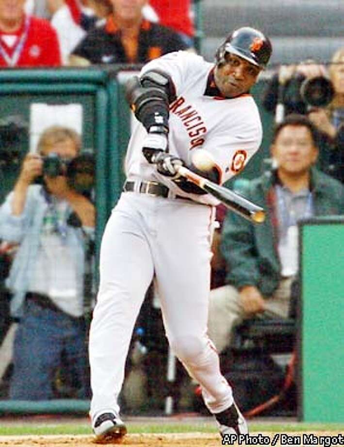 San Francisco Giants' Barry Bonds hits a solo home run in the first inning of Game 1 of the against the Anaheim Angels in Anaheim, Calif., Saturday, Oct. 19, 2002. (AP Photo/Ben Margot) Photo: BEN MARGOT