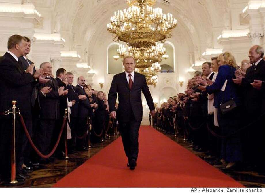 """Russian President Vladimir Putin walks through St.George's Hall to take part in an inauguration ceremony in Moscow's Kremlin, Friday, May 7, 2004. Putin starting his second term with a solemn inauguration ceremony in an ornate Kremlin hall Friday, nearly two months after easily winning re-election as leader of what he called a """"vast, great power."""" (AP Photo/Alexander Zemlianichenko, pool ) Photo: ALEXANDER ZEMLIANICHENKO"""