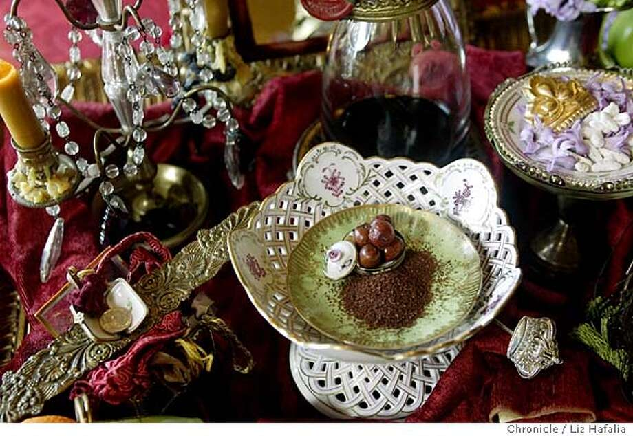 Shot in the home of Paiman Salimpour is the haft sinn--seven s's (apple, sumac, special desserts,...)--which is special table arrangements families display during Now Ruz. Haft sinn dates back to Zoroastrian religion.. Shot on 3/8/04 in Orinda. LIZ HAFALIA / The Chronicle Photo: LIZ HAFALIA