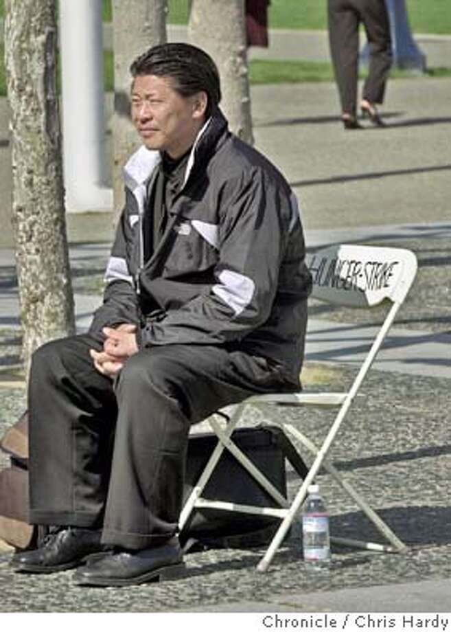 Pastor Roger Huang of the SF Rescue Mission is staging a hunger strike outside of City Hall. At issue is a strip club next door to the Rescue Mission at 230 Jones St. that he wants closed. He's sitting on a chair across the street from the main entrance of City Hall. He started at 12:30 yesterday afternoon.  City: SF, CA Event on 4/6/04 in San Francisco.  Chris Hardy / San Francisco Chronicle Photo: Chris Hardy