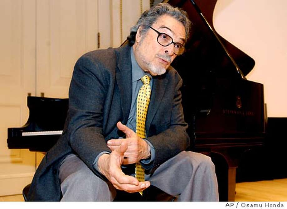 Leon Fleisher sits at a piano during a news conference Wednesday, March 31, 2004, at Carnegie Hall in New York. Fleisher, 75, who for years was able to perform using only his left hand because of a mysterious disease called dystonia, a neurological disorder of the brain which disrupts motor control of muscles, has been treated effectively with botox. (AP Photo/Osamu Honda) Photo: OSAMU HONDA