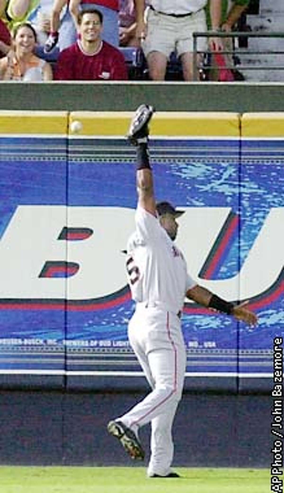 San Francisco Giants left fielder Barry Bonds is unbale to make the catch in a hit by Atlanta Braves' Marcus Giles during the second inning in Atlanta Thursday, Aug. 15, 2002. (AP Photo/John Bazemore)