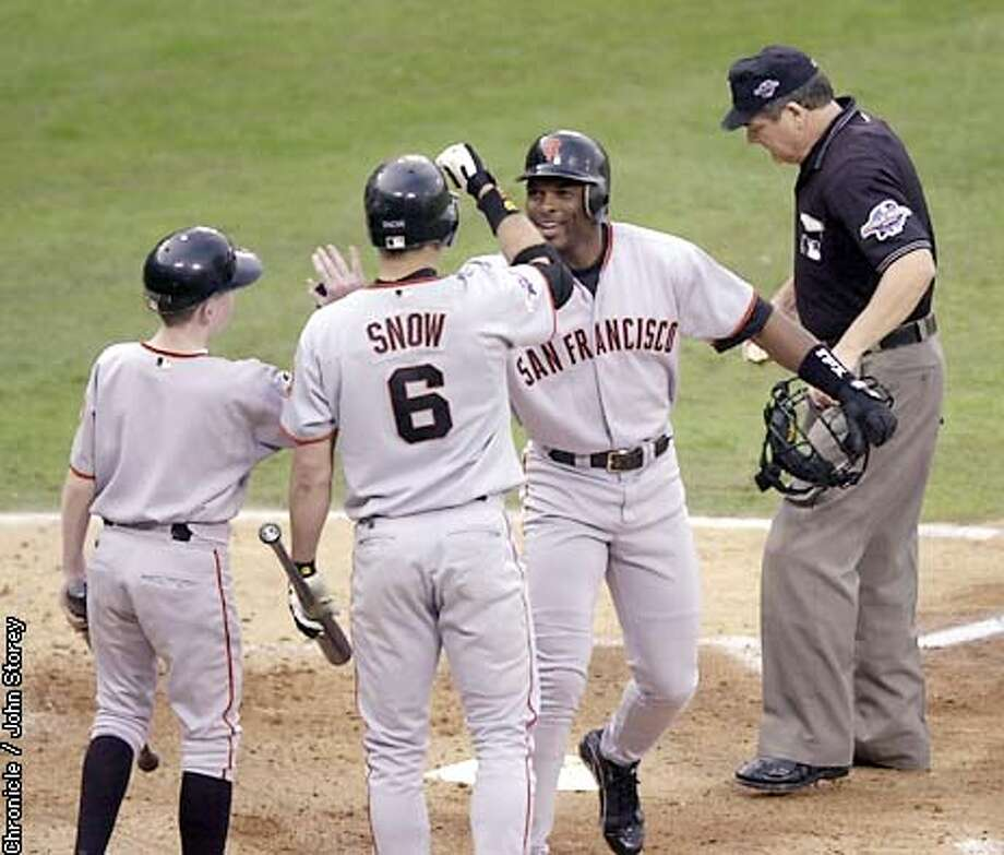Giants Reggie Sanders is welcomed at the plate after his second inning solo homerun. The San Francisco Giants play the Anaheim Angels in Game 1 of the World Series at Edison Field in Anaheim, Ca. October 19, 2002. John Storey/San Francisco Chronicle Photo: John Storey