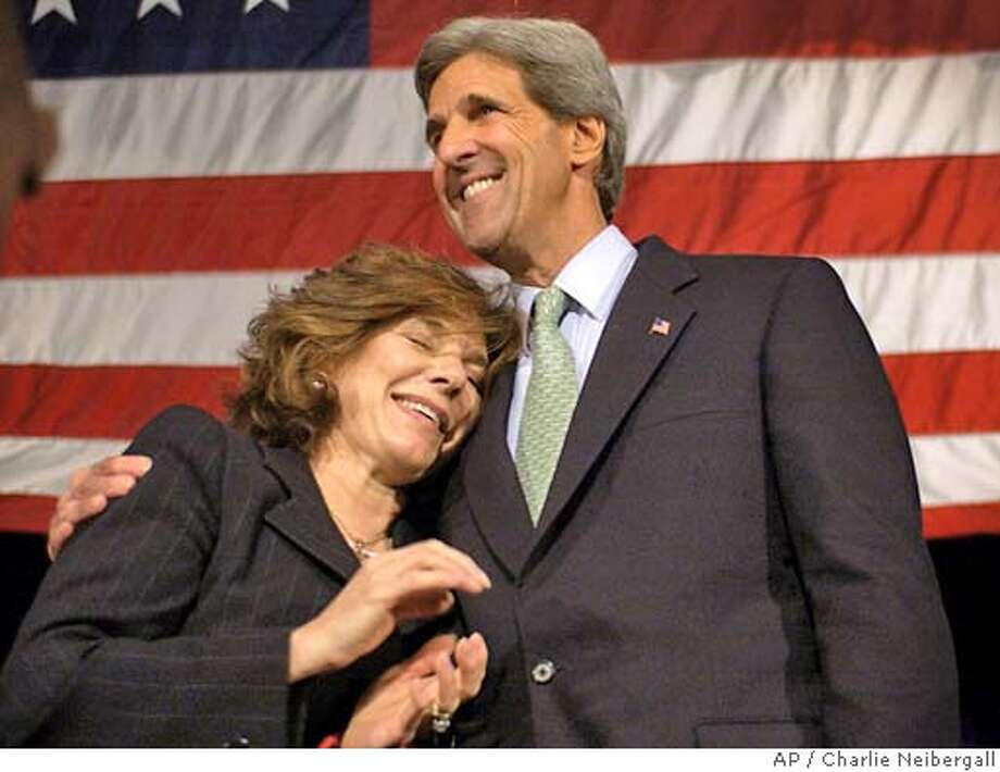 Democratic presidential candidate Sen. John , D-Mass., gets a hug from his wife Teresa Heinz after speaking at Colton High School, Thursday, May 6, 2004, in San Bernardino, California. (AP Photo/Charlie Neibergall) Photo: CHARLIE NEIBERGALL