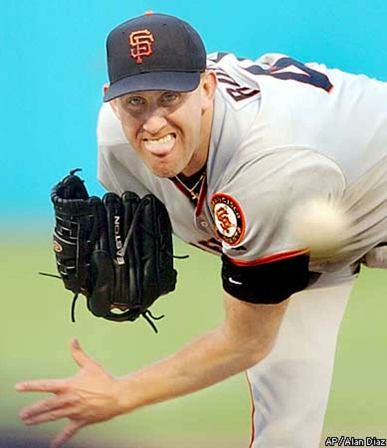 San Francisco Giants' Kirk Rueter pitches against the Florida Marlins in the first inning, Friday, Aug. 16, 2002, in Miami. (AP Photo/Alan Diaz) Photo: ALAN DIAZ