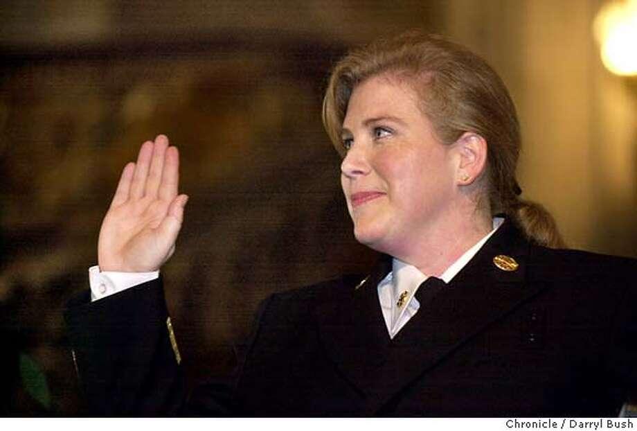 New fire chief, Joanne Hayes-White is sworn in by mayor Gavin Newsom at City Hall. 1/16/04 in San Francisco. DARRYL BUSH / The Chronicle Photo: DARRYL BUSH