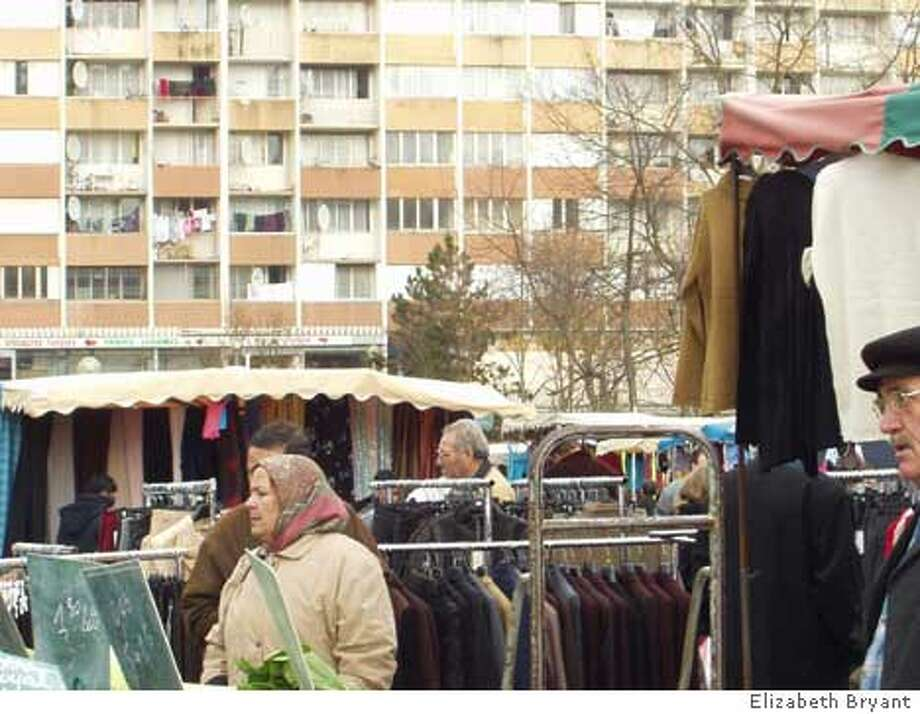 The weekly market in upper Montereau attracts many Muslim residents of the low-income area. Photo by Elizabeth Bryant