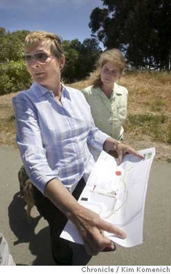 Marilyn Saarni of Berkeley and Missy Brosnan of Berkeley discuss a plan to protect leash-free space for dogs.  Dog owners react tothe proposed ban on unleashed dogs at Eastshore State Park, formerly known as the Albany Bulb.  Chronicle photo by Kim Komenich in Albany. Photo: Kim Komenich