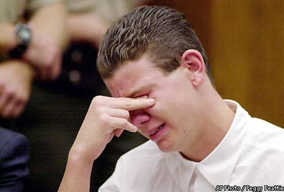 "Charles ""Andy"" Williams cries while apologizing to the court and victims' families during his sentencing hearing Thursday, Aug. 15, 2002, in El Cajon, Calif. Williams, who killed two students and wounded 13 others at Santana High School in March 2001 in Santee, Calif., was sentenced to 50 years to life in prison. (AP Photo/Pool, Peggy Peattie) Photo: PEGGY PEATTIE"