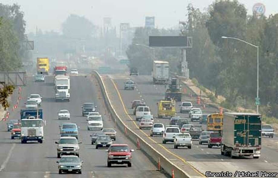 "Highway 99 cuts through Fresno, traffic along the corridor is one of the many practices that contribute to the poor air quality. The San Joaquin Valley has three of the most polluted metropolitan areas in the US. Between 8 and 10 percent of the centrasl valley population has a lung disease like asthma. The local air pollution board will voluntarily ask that the valley be upgraded to ""Extreme"" catergory of air pollution from ""Severe"" putting them in par with LA and giving them 5-7 more years to deal with the problem. by Michael Macor/The Chronicle Photo: MICHAEL MACOR"