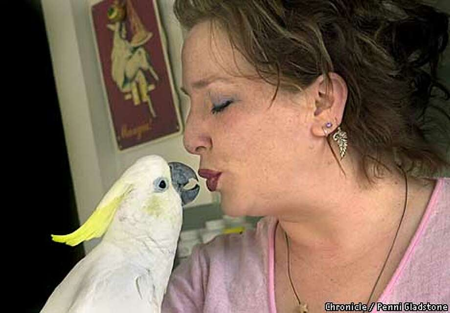 Raina Pipitone and her parrot Dee Story about owning Parrots and other birds of the species. Photo by Penni Gladstone/The San Francisco Chronicle) Photo: CARLOS AVILA GONZALEZ
