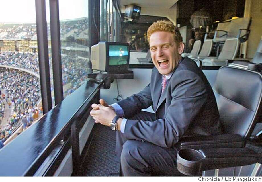 """Event on 5/6/04 in Oakland.  Nick Warnock, one of the final few on the reality TV show """"The Apprentice"""" watches the A's play the Yankees at Network Associates Coliseum. He has been hired by the Oakland Raiders.  Liz Mangelsdorf / The Chronicle Photo: Liz Mangelsdorf"""