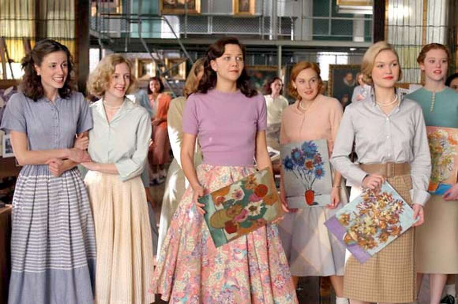 Maggie Gyllenhaal (center) and Julia Stiles (second from right) hold artwork in &quo;Mona Lisa Smile.&quo;