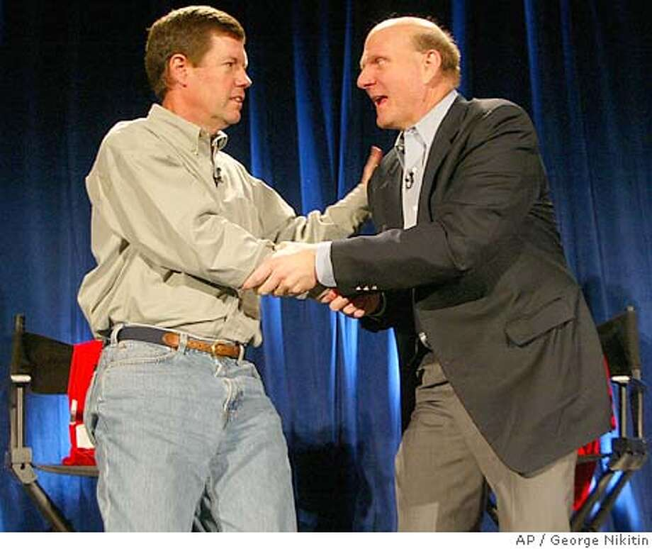 Microsoft CEO Steve Ballmer, right, shakes hands with Sun Microsystems CEO Scott McNealy after a news conference Friday, April 2, 2004, in San Francisco. Struggling server maker Sun Microsystems Inc. accepted a $1.6 billion settlement from Microsoft Corp. and said Friday it plans to cooperate with its longtime nemesis. The surprise agreement was accompanied by an announcement by Sun that it is cutting 3,300 jobs and that its net loss for the fiscal third quarter will be wider than expected. The cuts represent 9 percent of its total work force of more than 35,000. (AP Photo/George Nikitin) Scott McNealy, Sun Microsystems CEO (left), and Microsoft CEO Steve Ballmer shake hands at a news conference Friday. Photo: GEORGE NIKITIN