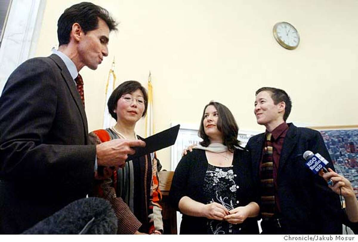 Georgia Kolias, second from right, and Willy Wilkinson, far right, get married by California Assemblyman Mark Leno, left, and City Assessor Mabel Teng, during a ceremony in San Francisco City Hall Thursday, Feb 12, 2004. In a political and legal challenge to California law, city authorities officiated at the marriages of at least eight same-sex couples Thursday and issued about a dozen more marriage licenses to gay and lesbian couples. The act of civil disobedience coordinated by top city officials pre-empted a conservative group's efforts to block Mayor Gavin Newsom's plan to license same-sex marriages. (AP Photo/Jakub Mosur) Georgia Kolias (second from right) and Willy Wilkinson (far right) are married by California Assemblyman Mark Leno (left) and City Assessor Mabel Teng, in San Francisco City Hall on Feb. 12. Willy Wilkinson (far right) and Georgia Kolias (second from right) exchange vows in a Feb. 12 ceremony led by Assemblyman Mark Leno (left) and City Assessor Mabel Teng at City Hall.