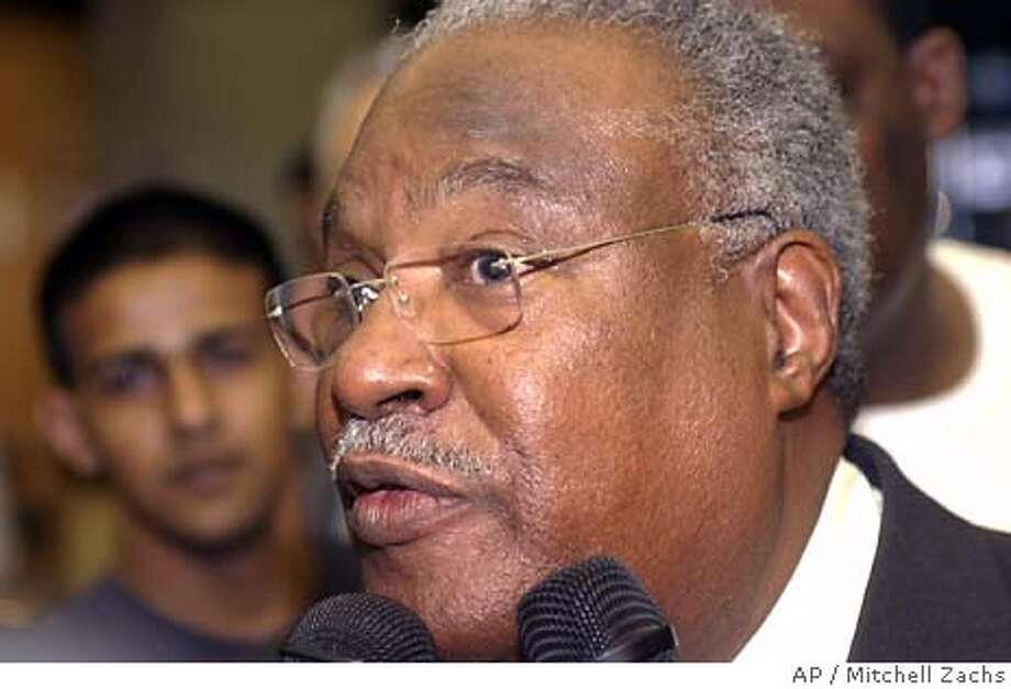 New Haitian Prime Minister Gerad Latortue, of Boca Raton, FL. is surrounded by media as he readies to board a plane to Haiti at Miami International Airport Wednesday March 10, 2004. (AP/Mitchell Zachs) Photo: Mitchell Zachs