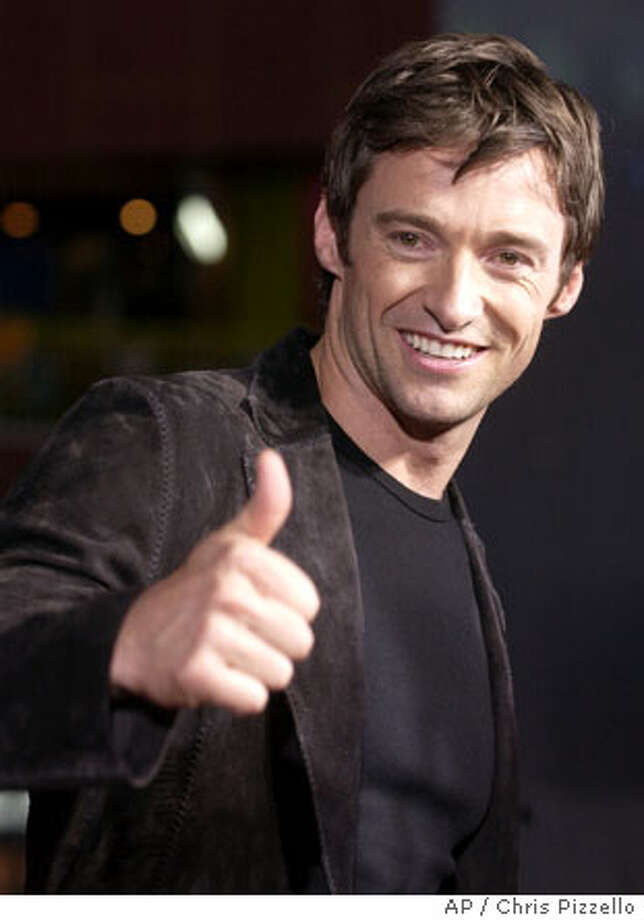 "Australian actor Hugh Jackman, star of the new film ""Van Helsing,"" gestures for photographers at the world premiere of the film in Universal City, Calif., Monday, May 3, 2004. (AP Photo/Chris Pizzello) Photo: CHRIS PIZZELLO"