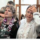 Jeanne Rizzo, right, puts her hand to her head next to her partner, Pali Cooper, as they learn they are too late to be married Thursday, March 11, 2004, in San Francisco. The California Supreme Court on Thursday ordered an immediate halt to gay marriages in San Francisco, delivering a victory to conservatives who have fought for a month to block the ceremonies. The court did not rule on the legality of gay marriages, and justices indicated they would decide in the coming months whether San Francisco's mayor had the authority to allow the weddings. (AP Photo/Ben Margot)
