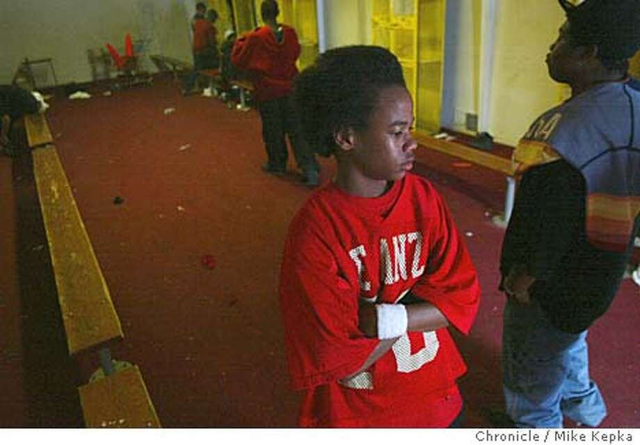 """""""Sports keep form a bad crowd,"""" said DeAnza High School freshman, Ronbin Bethea, 14, who stands inthe football locker room after hearing the news that West Contra Costa Schools will be cutting their sports, music and library programs next year. Bethea's phone # is 510 222-5534. The football coach, George Pye can be reached at 510 812-8849. Mike Kepka / The Chronicle Photo: Mike Kepka"""
