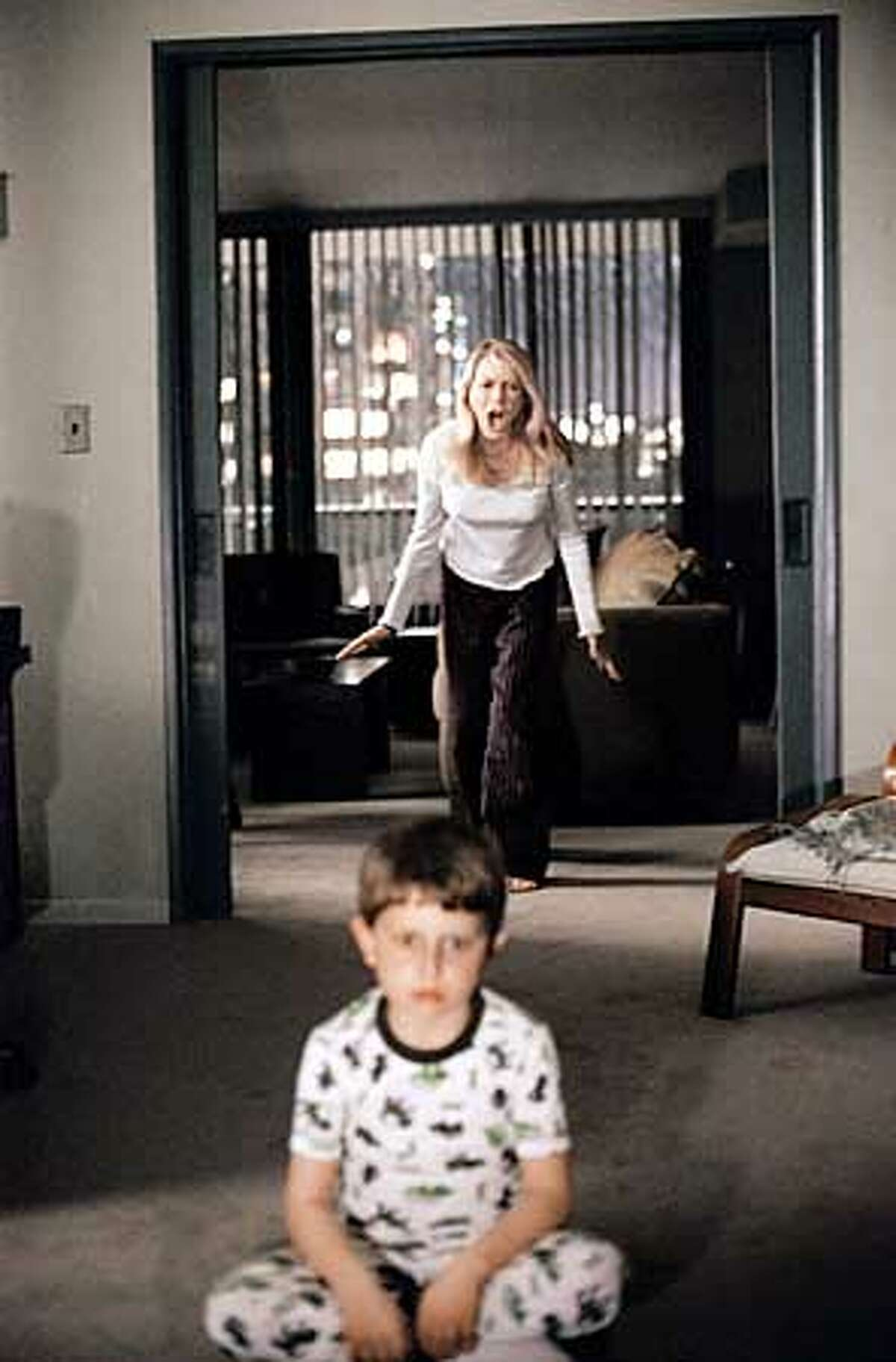 To her horror, Rachel Keller (NAOMI WATTS) finds she is too late to stop her son Aidan (DAVID DORFMAN) from watching a videotape that dooms anyone who sees it to death in seven days in DreamWorks Pictures� suspense thriller THE RING. Photo: Merrick Morton
